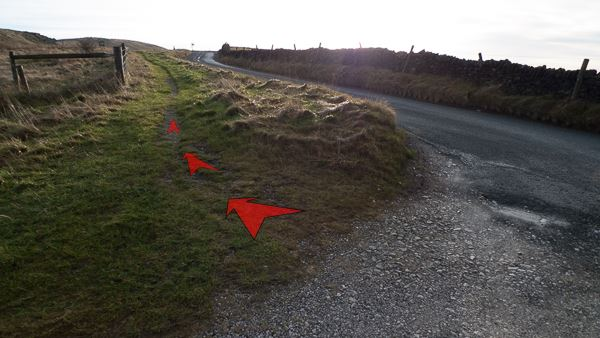 A photo of step 1 of the Cats Tor route, with red arrows superimposed to show the way.