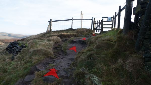 A photo of step 4 of the Cats Tor route, with red arrows superimposed to show the way.