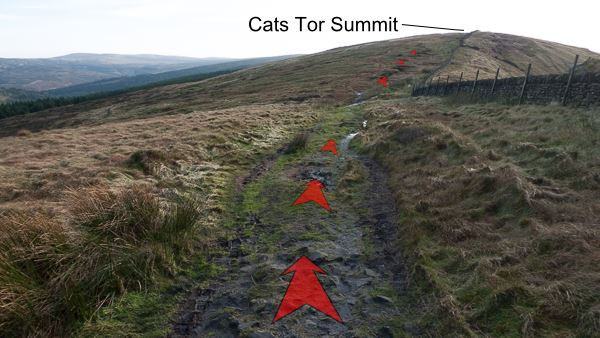 A photo of step 6 of the Cats Tor route, with red arrows superimposed to show the way.
