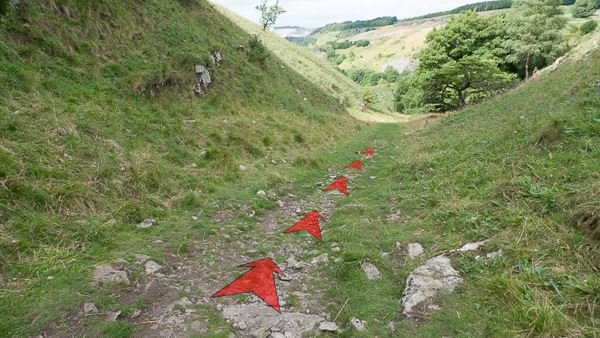 A photo of step 3 of the Chee Dale route, with red arrows superimposed to show the way.