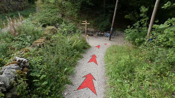 A photo of step 5 of the Chee Dale route, with red arrows superimposed to show the way.