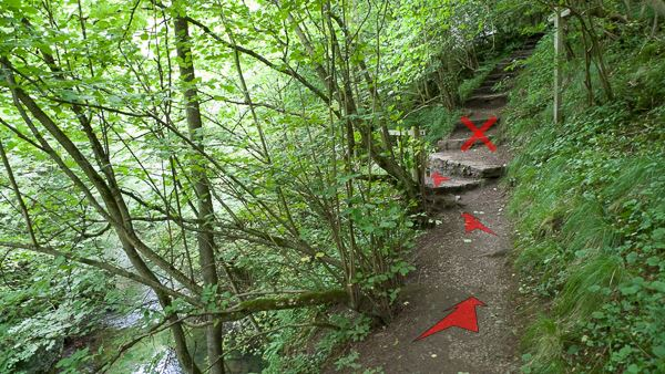 A photo of step 14 of the Chee Dale route, with red arrows superimposed to show the way.