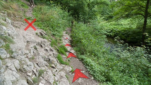 A photo of step 18 of the Chee Dale route, with red arrows superimposed to show the way.
