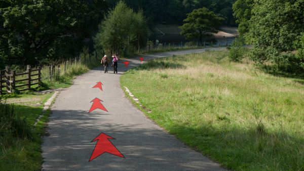 A photo of step 4 of the Fernilee Reservoir route, with red arrows superimposed to show the way.