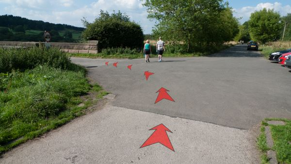 A photo of step 8 of the Fernilee Reservoir route, with red arrows superimposed to show the way.