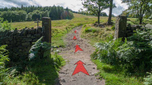 A photo of step 3 of the Shining Tor route, with red arrows superimposed to show the way.
