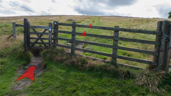 A photo of step 5 of the Shining Tor route, with red arrows superimposed to show the way.