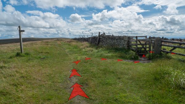 A photo of step 7 of the Shining Tor route, with red arrows superimposed to show the way.