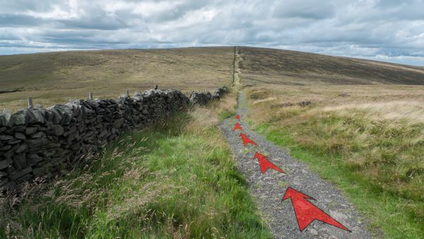 A photo of step 8 of the Shining Tor route, with red arrows superimposed to show the way.