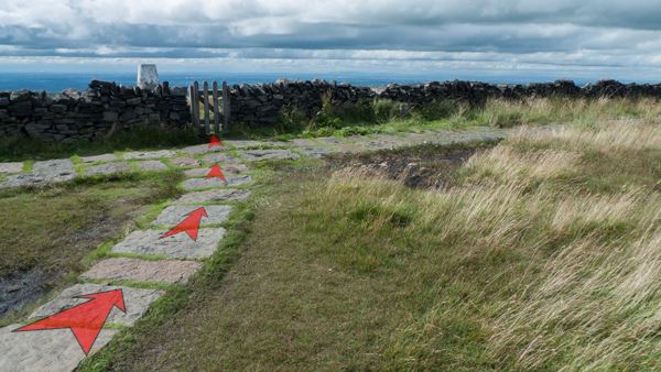 A photo of step 9 of the Shining Tor route, with red arrows superimposed to show the way.