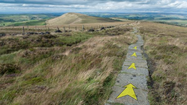 A photo of step 2 of the Shining Tor route, with yellow arrows superimposed to show the way.