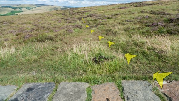 A photo of step 4 of the Shining Tor route, with yellow arrows superimposed to show the way.