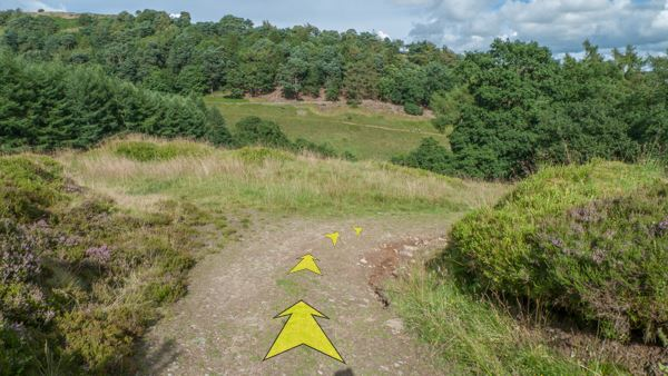 A photo of step 7 of the Shining Tor route, with yellow arrows superimposed to show the way.