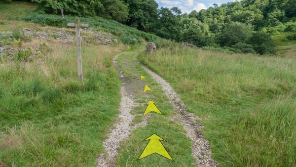A photo of step 8 of the Shining Tor route, with yellow arrows superimposed to show the way.