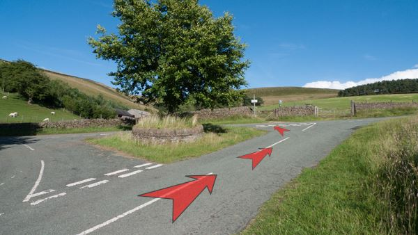 A photo of step 2 of the Three Shires Head route, with red arrows superimposed to show the way.