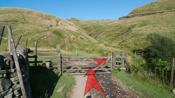 A photo of step 8 of the Three Shires Head route, with red arrows superimposed to show the way.