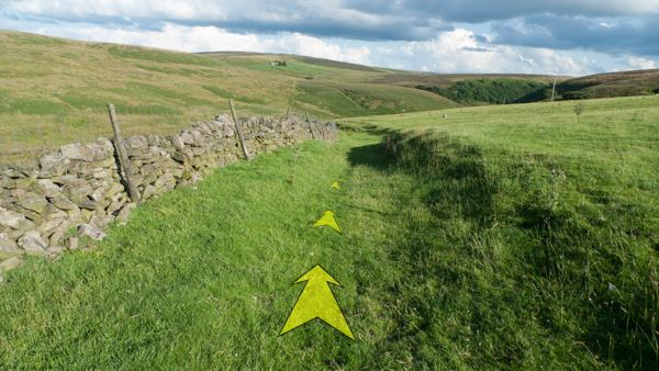 A photo of step 7 of the Three Shires Head route, with yellow arrows superimposed to show the way.