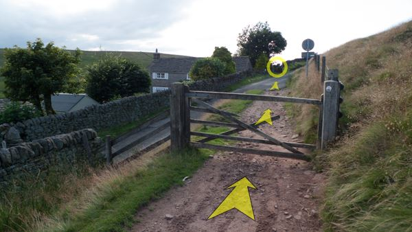 A photo of step 11 of the Three Shires Head route, with yellow arrows superimposed to show the way.