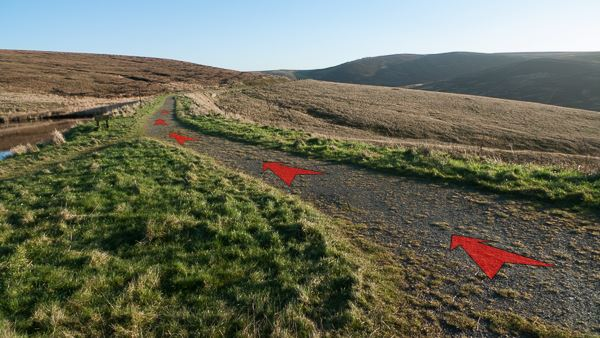 A photo of step 2 of the Wildmoorstone Valley route, with red arrows superimposed to show the way.