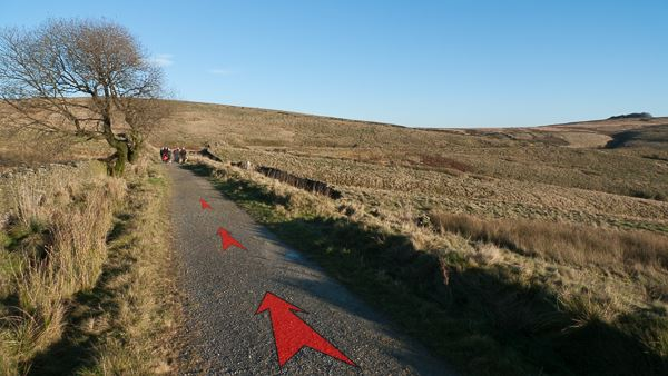 A photo of step 4 of the Wildmoorstone Valley route, with red arrows superimposed to show the way.