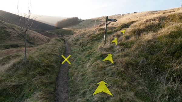 A photo of step 3 of the Wildmoorstone Valley route, with yellow arrows superimposed to show the way.