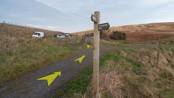A photo of step 5 of the Wildmoorstone Valley route, with yellow arrows superimposed to show the way.